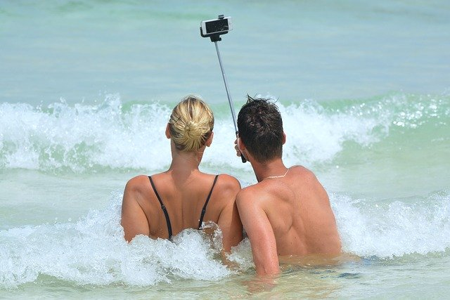 Couple taking a selfie by the beach